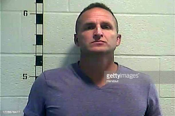 In this handout photo provided by the Shelby County Detention Center, former Louisville, Kentucky detective Brett Hankison poses for a mug shot on...