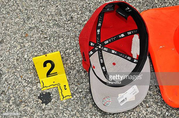 In this handout photo provided by the St. Louis County Prosecutor's Office, Michael Brown's hat is documented at the scene of the shooting on August...
