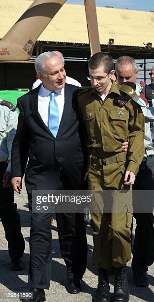 In this handout photo provided by the the Israeli Government Press Office Freed Israeli soldier Gilad Shalit is greeted by Israeli Prime Minister...