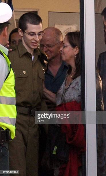In this handout photo provided by the the Israeli Government Press Office freed Israeli soldier Gilad Shalit meets with his mother Aviva and his...