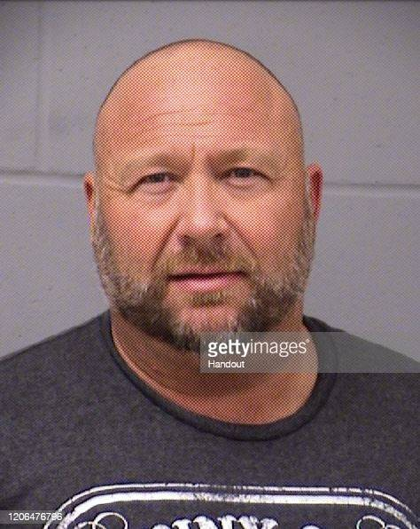 In this handout photo provided by the Travis County Sheriff's Office InfoWars founder Alex Jones is seen in a police booking photo in Austin after...