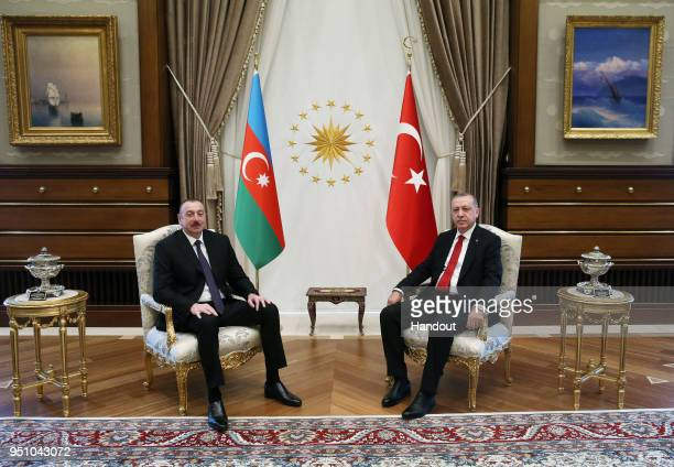 In this handout photo provided by The Turkish President Press office Turkish President Recep Tayyip Erdogan with Ilham Aliyev President of the...