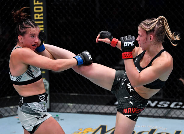 In this handout photo provided by the UFC, Miranda Maverick kicks Maycee Barber in their flyweight fight during the UFC Fight Night event at UFC APEX...