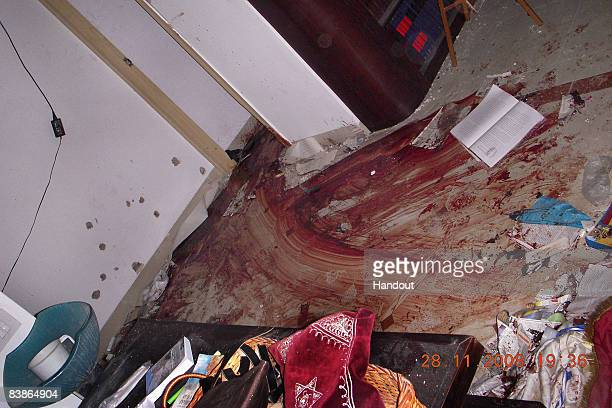 In this handout photo provided by the ultraOrthodox rescue organization ZAKA blood trails stain the floor amidst religious books and prayer shawls at...