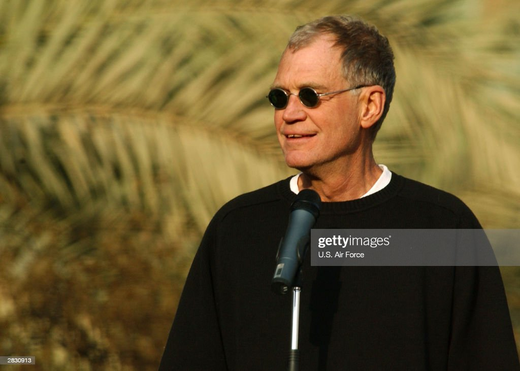 In this handout photo provided by the U.S. Air Force, 'Late Show' television host David Letterman entertains soldiers at the Coalition Provisional Authority headquarters December 24, 2003 in Baghdad, Iraq.