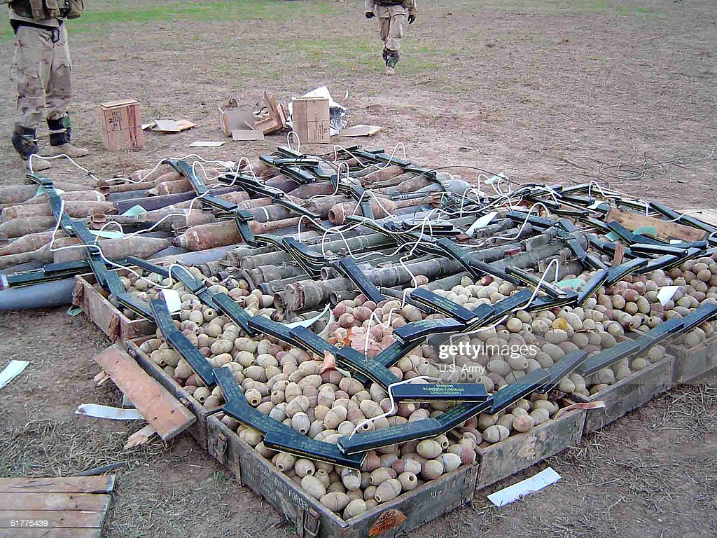 In this handout photo provided by the U.S. Army, a sample from one of the largest weapons caches found is seen November 22, 2004 approximately 45 km. south of Mosul in the village of Shafa?at, Iraq. Multi-National Forces from 1st Brigade, 25th Infantry Division (Stryker Brigade Combat Team) unearthed one of the largest weapons caches ever found in northern Iraq today. During their patrol, Soldiers from 2nd Battalion, 8th Field Artillery Regiment discovered huge stockpiles of weapons and munitions that consisted of one anti-aircraft gun, 15,000 anti-aircraft rounds, 4,600 hand grenades, 144 VOG-17M anti-personnel grenade launchers, 25 SA-7 surface-to-air missiles, 44 SA-7 battery packs, 20 guided missile packs, 21 120mm mortar rounds, two 120mm mortar tubes, 10 122mm rockets, six 152mm artillery rounds and two 57mm artillery rounds. Soldiers also discovered a building full of explosive-making materials. The 3-arce site is secure and still under investigation with more weapons and munitions discoveries expected.