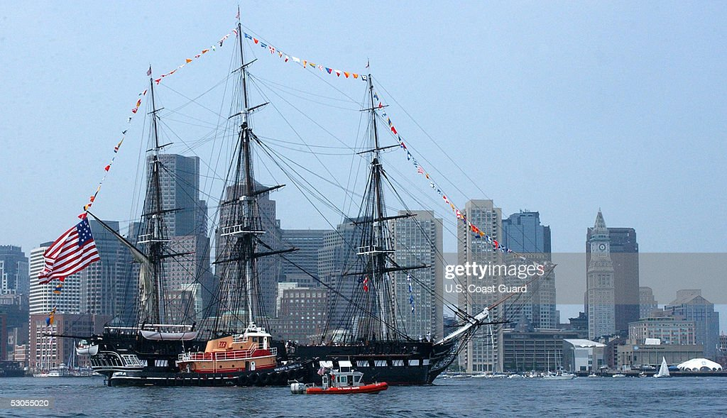 In this handout photo provided by the U.S. Coast Guard, multiple Coast Guard resources escort the USS Constitution, Boston's beloved 'Old Iron Sides,' June 11, 2005 in Boston, Massachusetts. The boat went out to an island in south Boston where the USS Constitution fired its 21 gun salute and was then brought back to her dock in Charlestown Navy Yard.