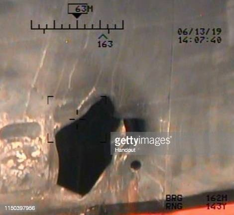 In this handout photo provided by the US Department of Defense imagery taken from a US Navy MH60R helicopter shows blast damage to M/T Kokuka...