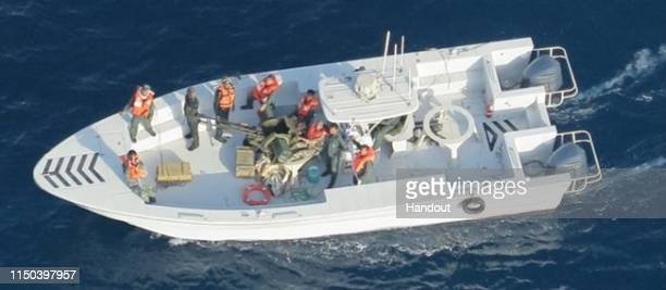 In this handout photo provided by the US Department of Defense imagery taken from a US Navy MH60R helicopter shows the Islamic Revolutionary Guard...