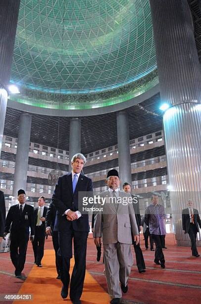 In this handout photo provided by the US Department of State US Secretary of State John Kerry tours the Istiqlal Mosque with Grand Imam KH Ali...