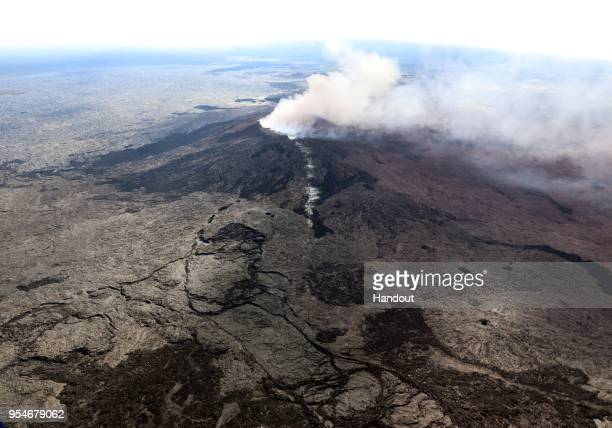 In this handout photo provided by the U.S. Geological Survey, a fissure forms on the west flank of the Puu Oo crater on Hawaii's Kilauea volcano on...