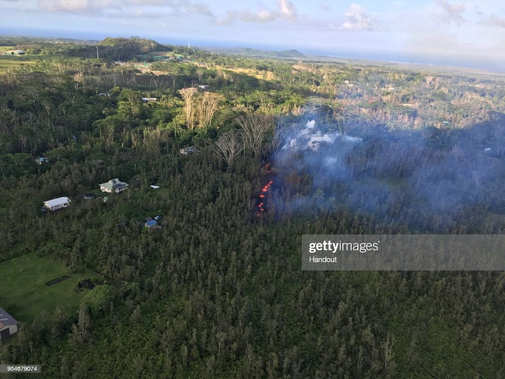In this handout photo provided by the U.S. Geological Survey, a fissure produces lava after the eruption of Hawaii's Kilauea volcano on May 3, 2018 in the Leilani Estates subdivision near Pahoa, Hawaii. The governor of Hawaii has declared a local state of emergency near the Mount Kilauea volcano after it erupted following a 5.0-magnitude earthquake, forcing the evacuation of nearly 1,700 residents.