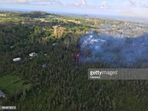 In this handout photo provided by the US Geological Survey a fissure produces lava after the eruption of Hawaii's Kilauea volcano on May 3 2018 in...