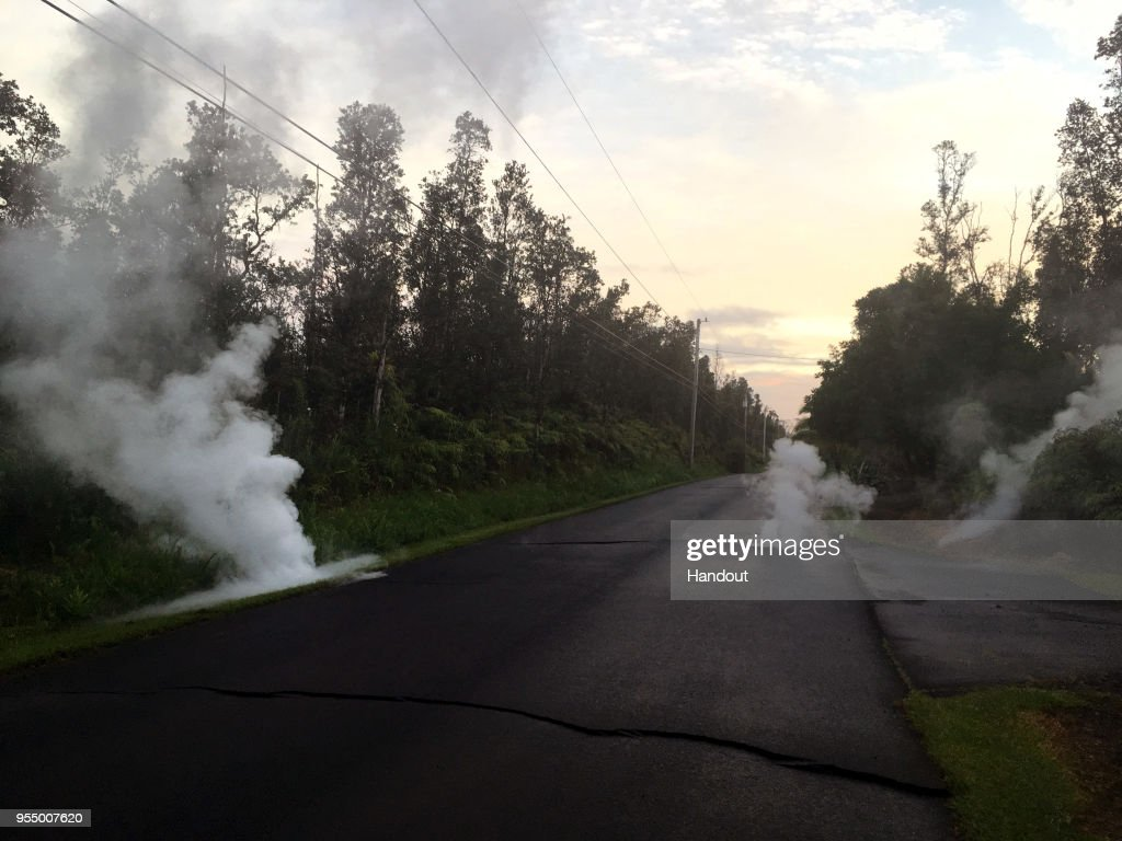 In this handout photo provided by the U.S. Geological Survey, a fissure produces steam from a street after the eruption of Hawaii's Kilauea volcano on May 4, 2018 in the Leilani Estates subdivision near Pahoa, Hawaii. The governor of Hawaii has declared a local state of emergency near the Mount Kilauea volcano after it erupted following a 5.0-magnitude earthquake, forcing the evacuation of nearly 1,700 residents.