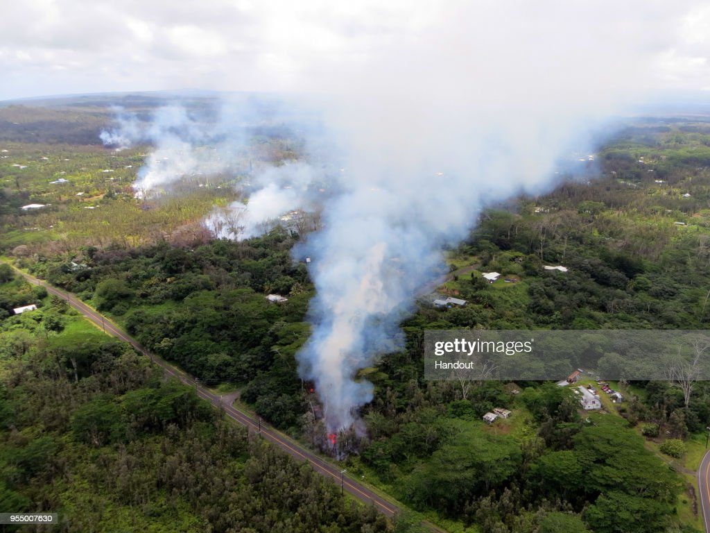 In this handout photo provided by the U.S. Geological Survey, a fissure produces lava after the eruption of Hawaii's Kilauea volcano on May 4, 2018 in the Leilani Estates subdivision near Pahoa, Hawaii. The governor of Hawaii has declared a local state of emergency near the Mount Kilauea volcano after it erupted following a 5.0-magnitude earthquake, forcing the evacuation of nearly 1,700 residents.