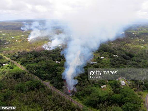 In this handout photo provided by the US Geological Survey a fissure produces lava after the eruption of Hawaii's Kilauea volcano on May 4 2018 in...