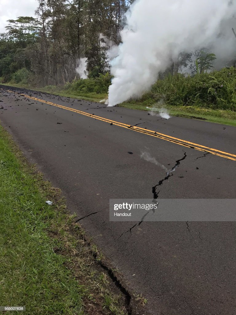 In this handout photo provided by the U.S. Geological Survey, a fissure produces steam on Leilani Street after the eruption of Hawaii's Kilauea volcano on May 4, 2018 in the Leilani Estates subdivision near Pahoa, Hawaii. The governor of Hawaii has declared a local state of emergency near the Mount Kilauea volcano after it erupted following a 5.0-magnitude earthquake, forcing the evacuation of nearly 1,700 residents.
