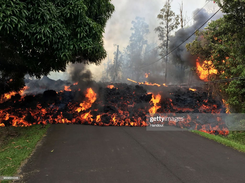 In this handout photo provided by the U.S. Geological Survey, a lava flow moves on Makamae Street after the eruption of Hawaii's Kilauea volcano on May 6, 2018 in the Leilani Estates subdivision near Pahoa, Hawaii. The governor of Hawaii has declared a local state of emergency near the Mount Kilauea volcano after it erupted following a 5.0-magnitude earthquake, forcing the evacuation of nearly 1,700 residents.