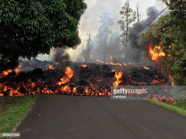 In this handout photo provided by the US Geological Survey a lava flow moves on Makamae Street after the eruption of Hawaii's Kilauea volcano on May...