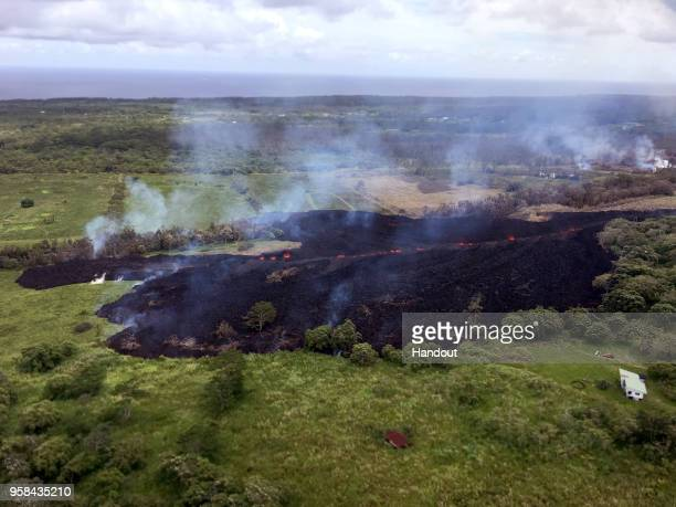 In this handout photo provided by the US Geological Survey a lava flow emerges from a fissure as a result of Kilauea volcano activity on Hawaii's Big...