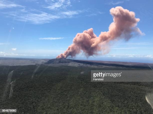 In this handout photo provided by the US Geological Survey ash sprews from the Puu Oo crater on Hawaii's Kilauea volcano on May 3 2018 in Hawaii...