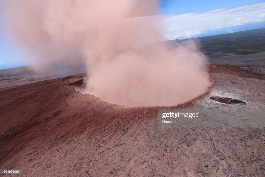 In this handout photo provided by the U.S. Geological Survey, ash sprews from the Puu Oo crater on Hawaii's Kilauea volcano on May 3, 2018 in Hawaii Volcanoes National Park. The governor of Hawaii has declared a local state of emergency near the Mount Kilauea volcano after it erupted following a 5.0-magnitude earthquake, forcing the evacuation of nearly 1,700 residents.