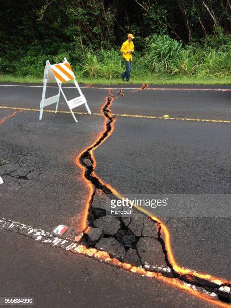 In this handout photo provided by the US Geological Survey ground cracking extends across Highway 130 on May 7 2018 in Puna Hawaii USGSHVO scientists...