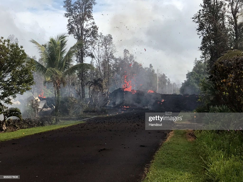 In this handout photo provided by the U.S. Geological Survey, lava pours across the road at Leilani and Kaupili Streets after the eruption of Hawaii's Kilauea volcano on May 4, 2018 in the Leilani Estates subdivision near Pahoa, Hawaii. The governor of Hawaii has declared a local state of emergency near the Mount Kilauea volcano after it erupted following a 5.0-magnitude earthquake, forcing the evacuation of nearly 1,700 residents.