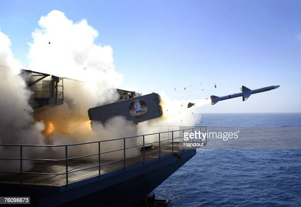 In this handout photo provided by the U.S. Navy, a RIM-7P NATO Sea Sparrow Missile launches the Nimitz-class aircraft carrier USS Abraham Lincoln...