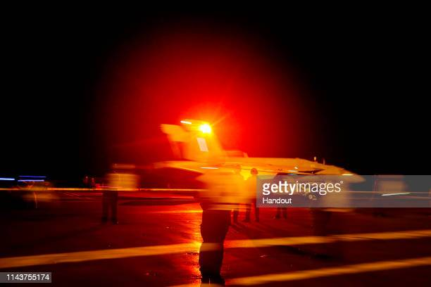 In this handout photo provided by the US Navy an F/A18E Super Hornet from the Sidewinders of Strike Fighter Squadron 86 launches from the flight deck...