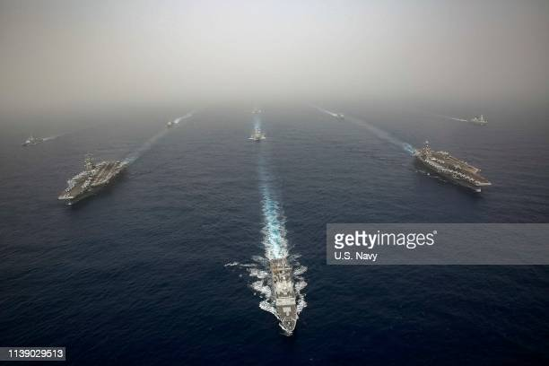 In this handout photo provided by the US Navy the Abraham Lincoln and John C Stennis Carrier Strike Groups conduct carrier strike force operations in...