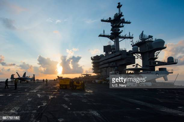 In this handout photo provided by the US Navy the aircraft carrier USS Carl Vinson transits the South China Sea on April 8 2017 The Carl Vinson...