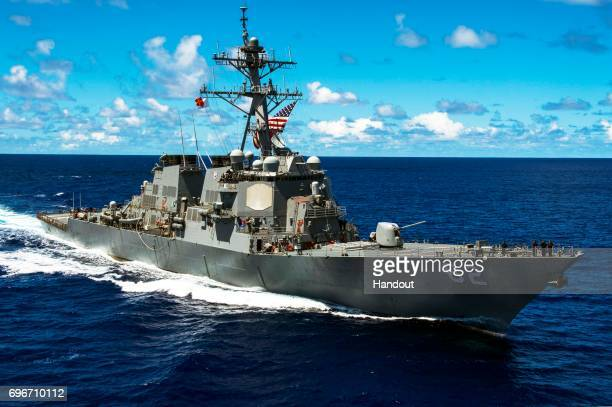 In this handout photo provided by the U.S. Navy, the Arleigh Burke class guided-missile destroyer USS Fitzgerald is on patrol on Sept. 8 in the U.S....