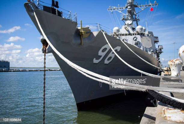 In this handout photo provided by the U.S. Navy, the guided-missile destroyer USS Bainbridge utilizes heavy weather mooring to secure itself to the...