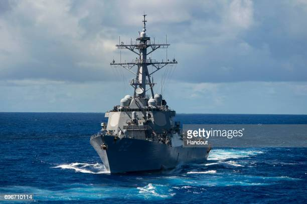 In this handout photo provided by the U.S. Navy, the guided-missile destroyer USS Fitzgerald is underway on August 20, 2013 in the Pacific Ocean....