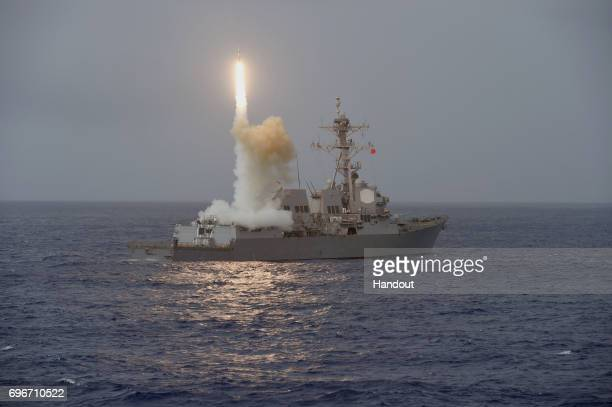 In this handout photo provided by the US Navy the guidedmissile destroyer USS Fitzgerald launches a missile from the aft missile deck during...