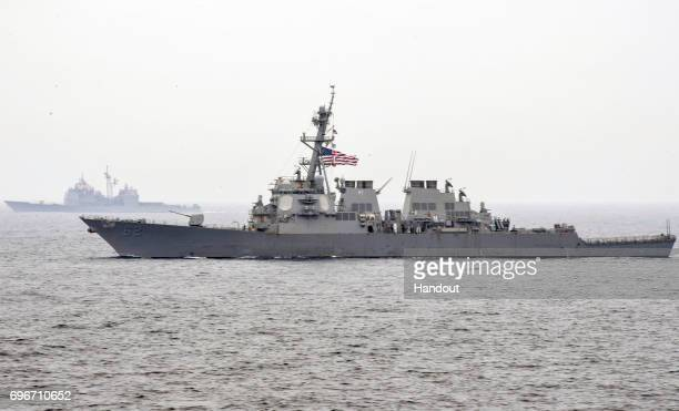 In this handout photo provided by the US Navy the guidedmissile destroyer USS Fitzgerald is underway with the Carl Vinson Carrier Strike Group on...
