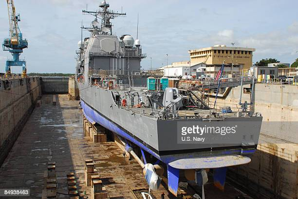 In this handout photo provided by the US Navy the guidedmissile cruiser USS Port Royal sits in drydock at the Pearl Harbor Naval Shipyard as it is...