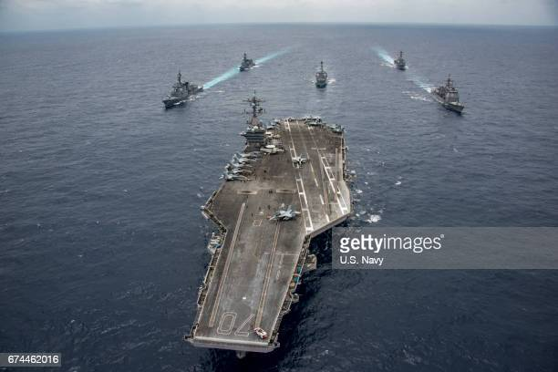 In this handout photo provided by the U.S. Navy, the Nimitz-class aircraft carrier USS Carl Vinson leads the Japan Maritime Self-Defense Force...