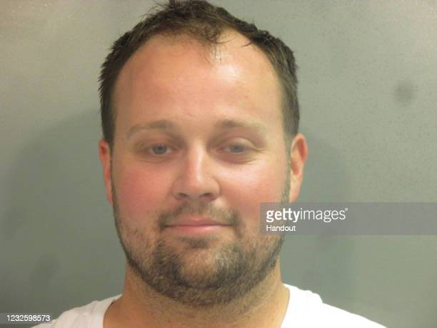 """In this handout photo provided by the Washington County Sheriff's Office, former television personality on """"19 Kids And Counting"""" Josh Duggar poses..."""
