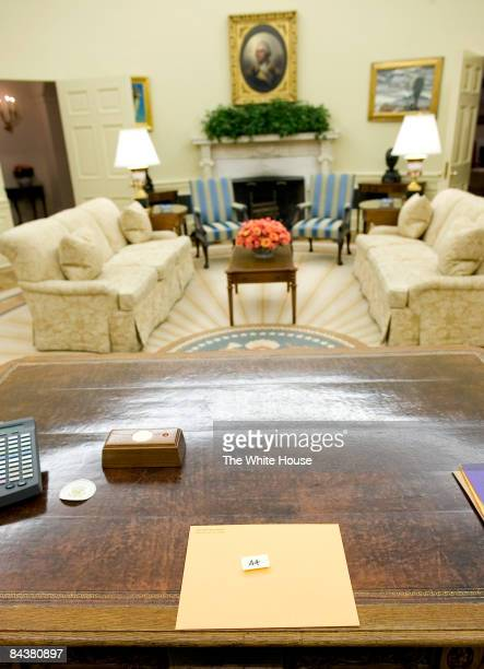 In this handout photo provided by the White House a folder for US President Barack Obama left by Former US President George W Bush sits on the...