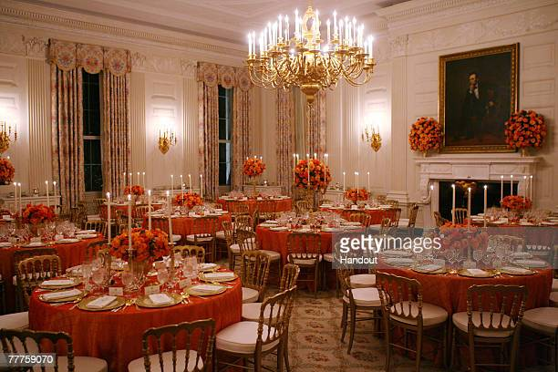 In this handout photo provided by The White House Decorated candlelit tables are seen in the State Dining Room of the White House on November 6 2007...