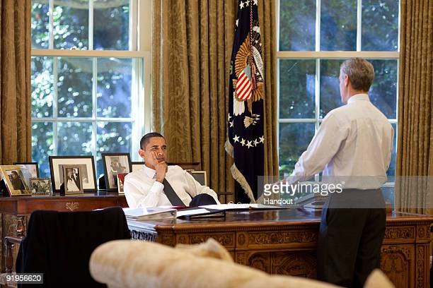 In this handout photo provided by the White House President Barack Obama meets with White House Chief of Staff Rahm Emanuel in the Oval Office of the...