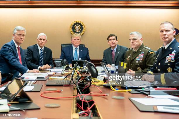 In this handout photo provided by the White House President Donald J Trump is joined by Vice President Mike Pence National Security Advisor Robert...