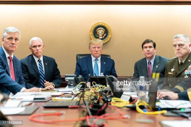 In this handout photo provided by the White House, President Donald J. Trump is joined by Vice President Mike Pence , National Security Advisor...