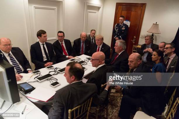 In this Handout photo provided by The White House President Donald J Trump receives a briefing on a military strike on Syria from his National...