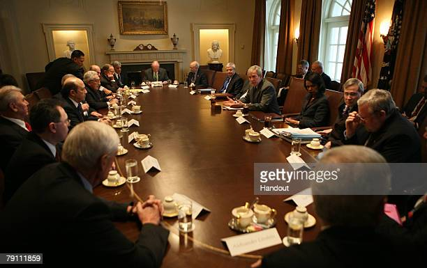 In this handout photo provided by the White House, U.S. President George W. Bush meets with Dr. Henry Kissinger , former Russian Prime Minister...
