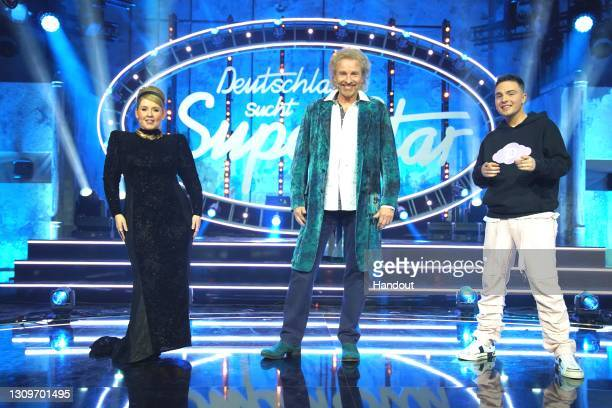 In this handout photo provided by TVNOW, jury members Maite Kelly, Thomas Gottschalk and Mike Singer pose during the semi finals of the tv show...
