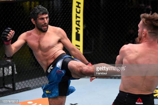 In this handout photo provided by UFC, Beneil Dariush of Iran kicks Scott Holtzman in their lightweight fight during the UFC Fight Night event at UFC...