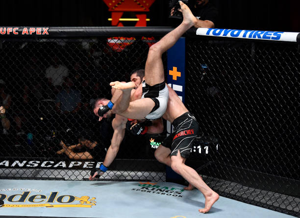 In this handout photo provided by UFC, Islam Makhachev of Russia takes down Thiago Moises of Brazil in their lightweight bout during the UFC Fight...